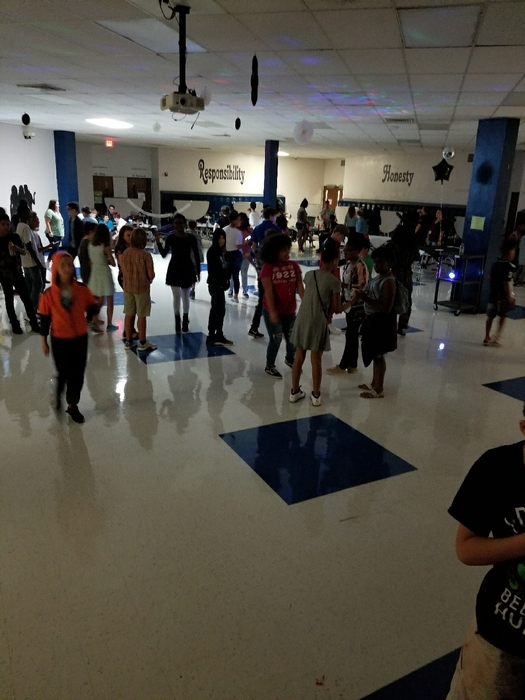 having fun at the 7th/8th grade welcome back dance!
