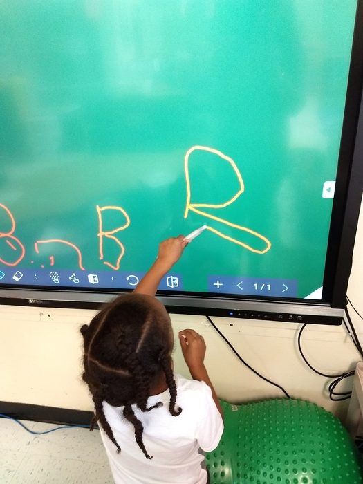 EC working on writing the letter B on our new ViewSonic Board.