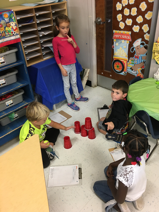 Kindergarten scientists investigating collisions.