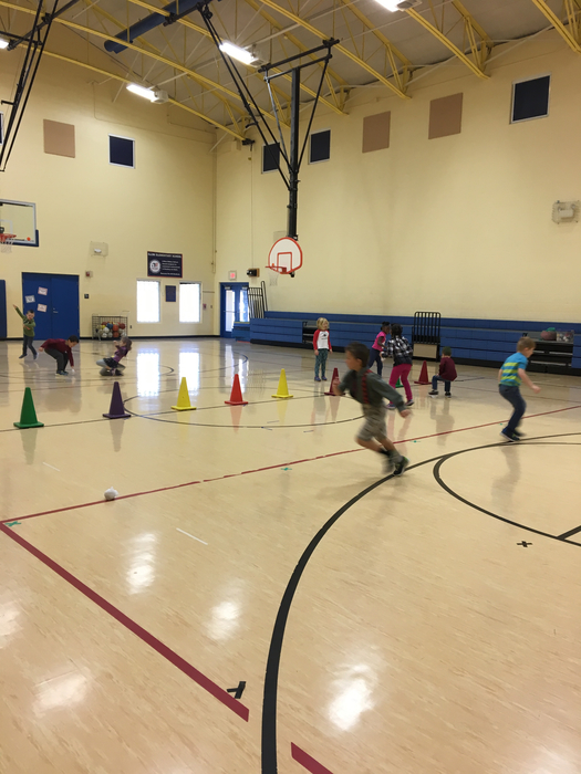 "1st grade practicing their throwing skills in a game called ""Ghostbusters"""