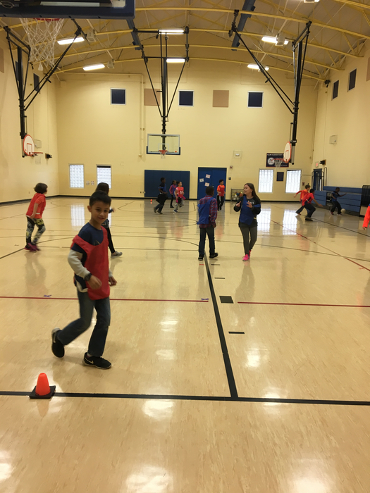 4th grade learning offense and defense positions during a game of soccer