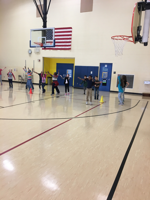 2nd graders celebrating with Jumping Jacks after building their Hula Huts!