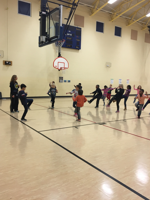2nd graders having fun learning about kickboxing