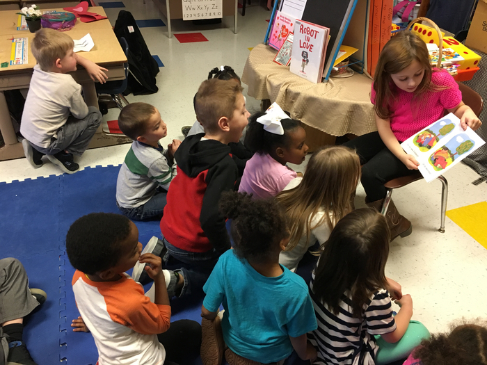 First Grader, Rylee, reads to Mrs. Jobe's Kindergarten Class