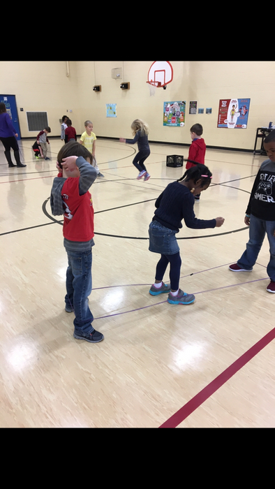 Kindergartners working in small groups using a Chinese Jump Rope