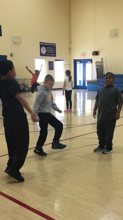 3rd graders working together with the Chinese Jump Rope