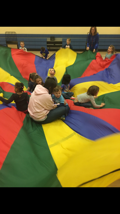 Pre-K having fun on the Parachute