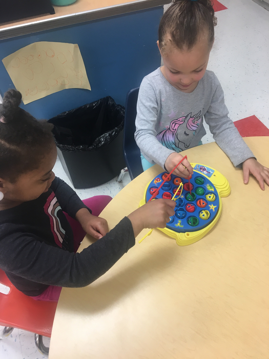 PreK is working hard on hand eye coordination and problem solving skills!
