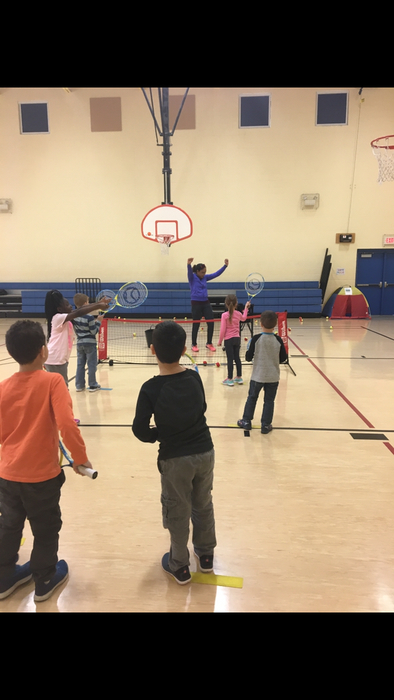 Kindergarten learning tennis!