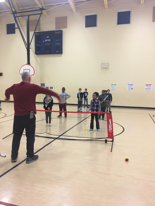 3rd grade learning tennis!