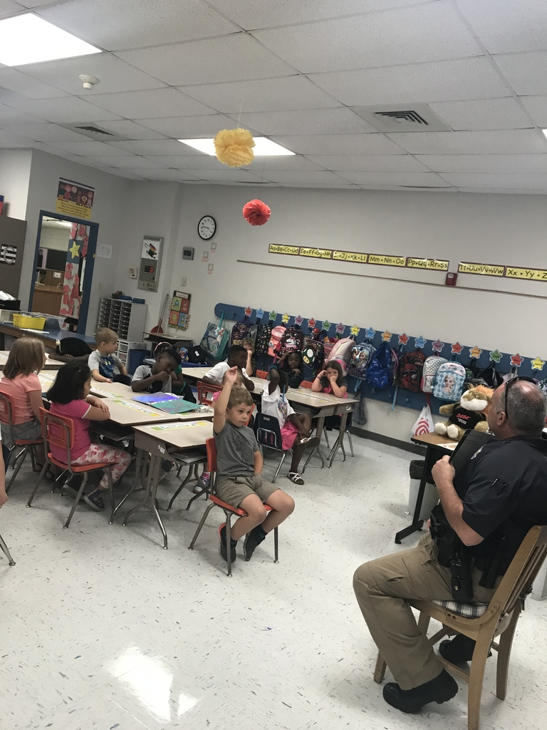 Officer Jim teaching first grade when to call 911