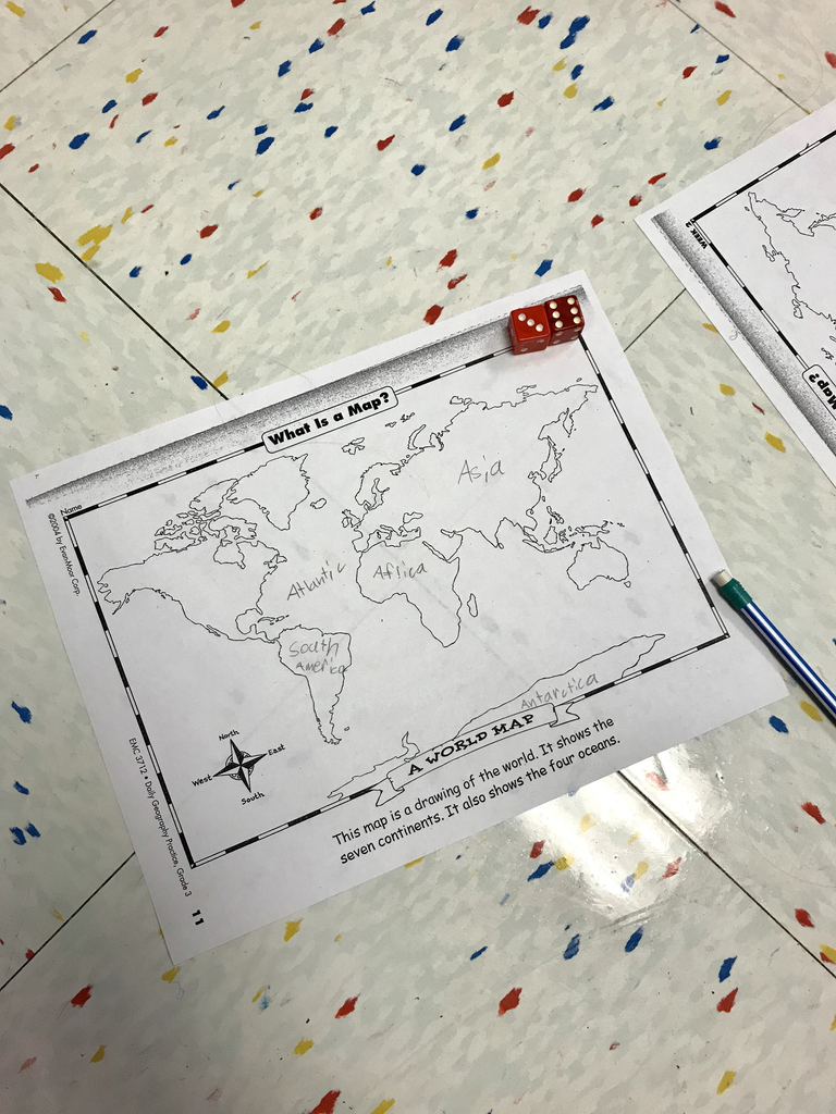 "Studying continents and oceans by playing ""Roll-a-Map"". Who will fill in the map of the world first? 🗺"