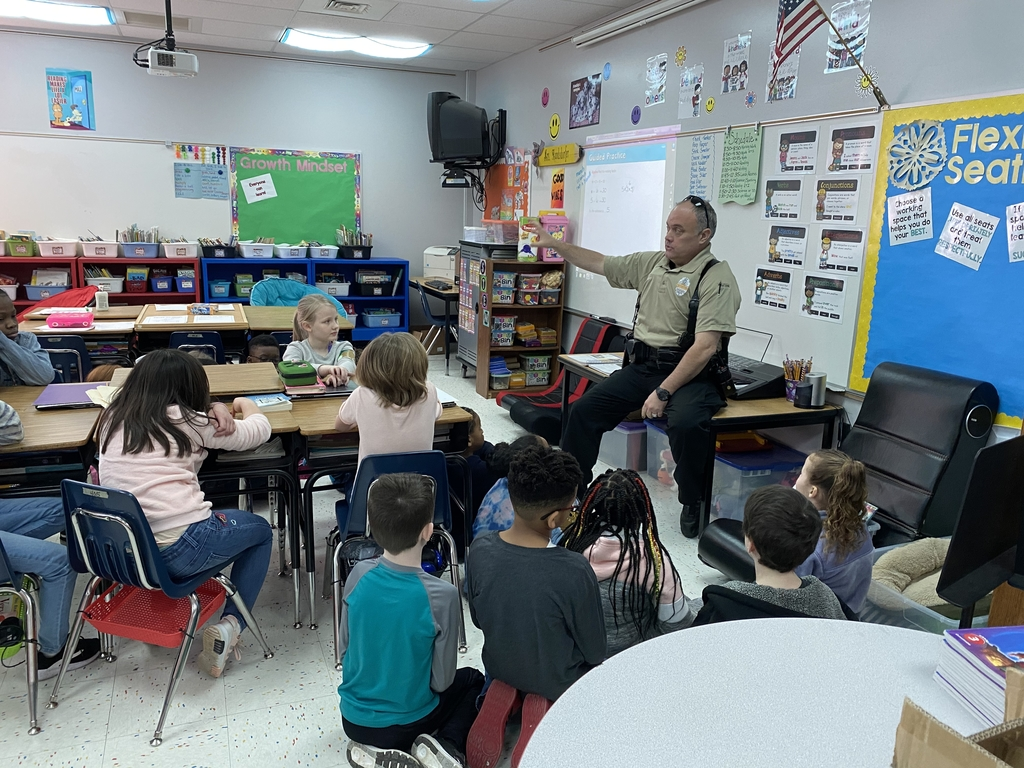 Our story this week is called Aero and Officer Mike. It teaches readers about what it is like to work with a police dog. Officer Hinson came to talk to some third graders about his experience training and working with police dogs throughout his career.